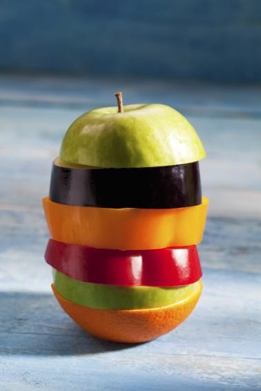 Apple, aubergine, paprika, orange slices stacked