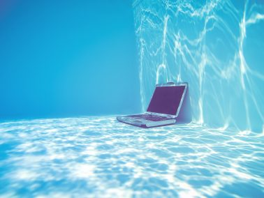 A laptop underwater in a swimming pool